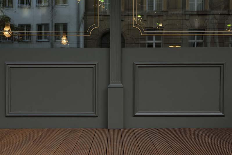 Foto einer dunkel gestrichenen Holzfassade mit Glasfront