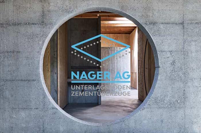 Rundes Fenster mit Logo der Nager AG